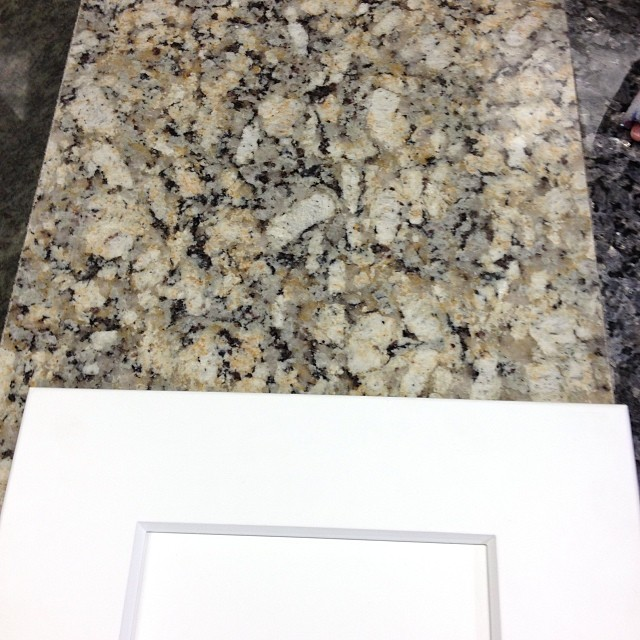 White Cabinets with Giallo Napoleon Granite